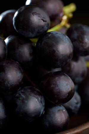 Foto für Macro shot of dark purple grape on wooden plate. High resolution - Lizenzfreies Bild