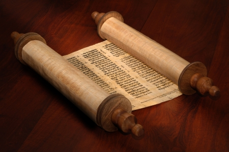 Ancient scrolls of papyrus paper with Hebrew text