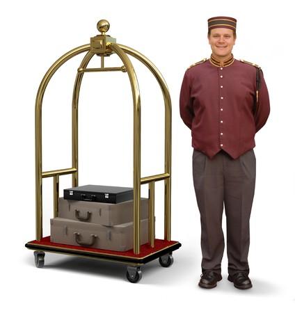 Photo pour Bellhop in retro uniform and luggage cart on a white background  - image libre de droit
