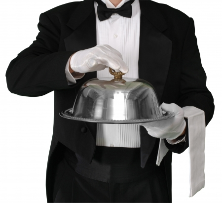 Waiter with tray about to lift the silver catering dome, isolated on white