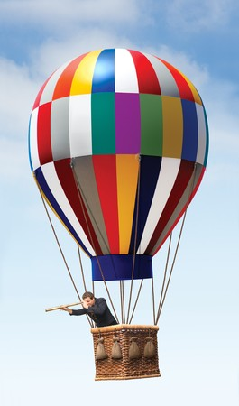 Businessman in a hot air balloon looking with a teleescope