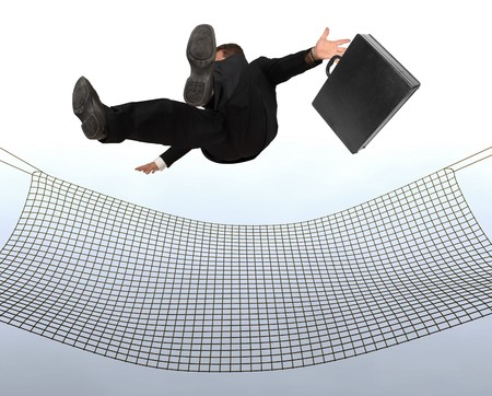 Businessman falling the Sky into a safty net