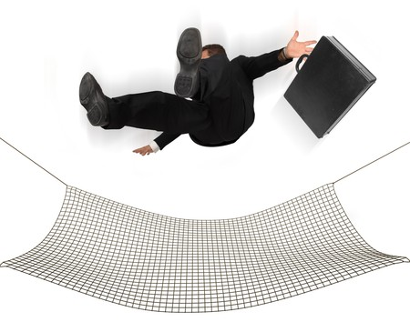 Businessman falling into a safety net on a white background