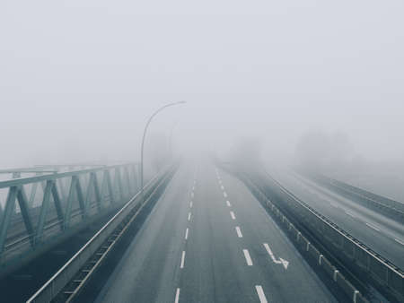 Road disappears into fog