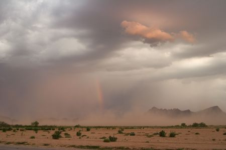 Desert dust storm, or haboob, with rainbow at sunsetの写真素材
