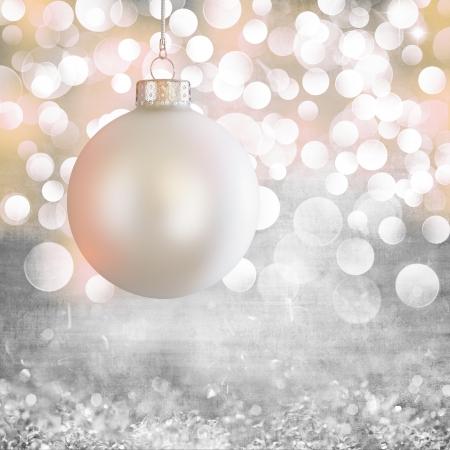 Vintage White Christmas Ball Ornament Over Elegant Grunge Grey, Purple, Pink , Gold Christmas Light Bokeh & Crystal Background