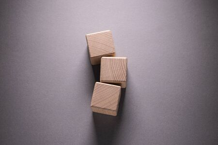 Foto für Wooden Geometric Shapes Cube on a paper background , This can use for past your words - Lizenzfreies Bild