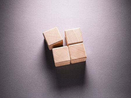 Photo for Wooden Geometric Shapes Cube on a paper background , This can use for past your words - Royalty Free Image