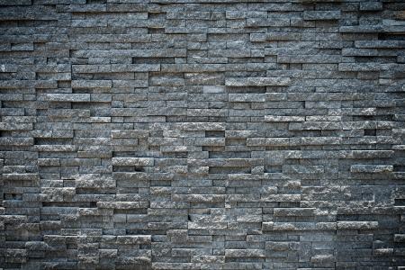 Photo pour random black granite stone wall, grungy style  - image libre de droit