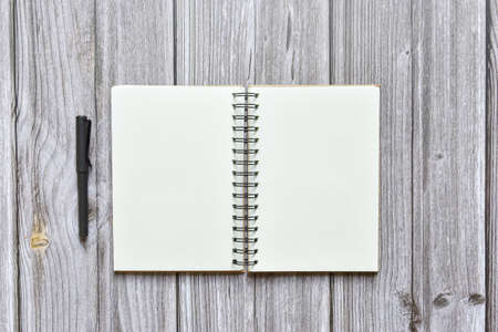 Photo pour Still life, business office supplies or education concept, Top view image of open notebook and fountain pen with blank pages on old brown wooden background, ready for adding text - image libre de droit