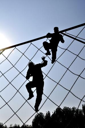 silhouette of athlete climbing