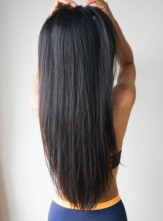 Photo pour Young woman Asian with beautiful long straight black hair. - image libre de droit