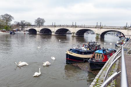 Kingston upon Thames, United Kingdom - April 2018: Local boat docking at Riverside Walk promenade by the River Thames in Kingston, England