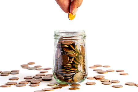 Foto de Save money and account banking for finance business concept, Coin money in bottle on white background, Savings for retirement and investing concept - Imagen libre de derechos