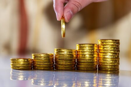 Foto de Save money and account banking for finance business concept, Hand with coin money on blurred background - Imagen libre de derechos