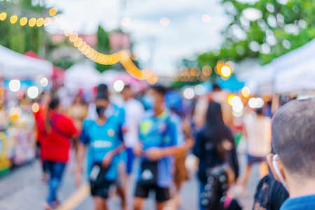 Photo pour Abstract blur, people walking on street in food festival with light bokeh, Blurred for background design - image libre de droit