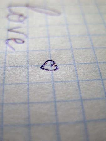 Heart on a sheet on notebook