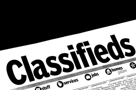 CLASSIFIEDS section of the newspaper