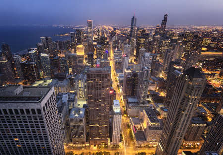 The buildings in Chicago city seen from  above at night
