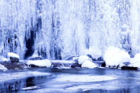 Beautiful winter landscape with frozen waterfall ice