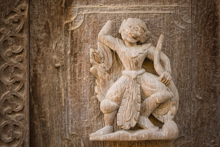 Photo pour Archaeological, Close Up of carved art figures on old wood carvings on the wall temple at Shwe Nan Daw Kyaung (Golden Palace Monastery) in Mandalay, Myanmar - image libre de droit