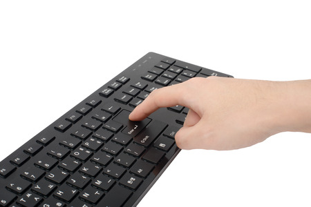 hand of press enter key, isolated on white