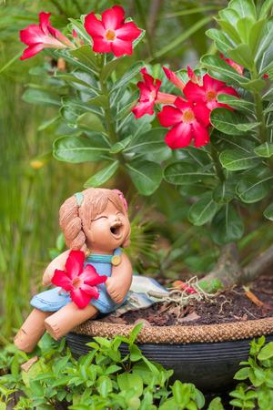 Ceramic girl under the tree
