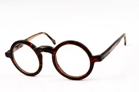 The old glasses on white background in studio