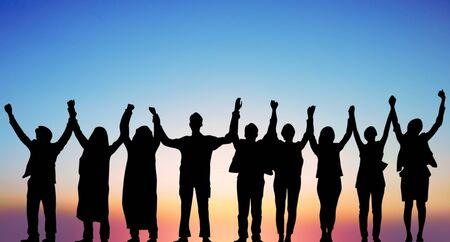 Foto de Success of teamwork collaboration and freedom on silhouette sunset background. business concept. - Imagen libre de derechos