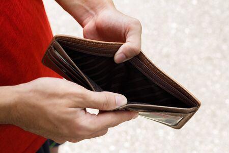 Photo pour A Closeup hand man open an Empty Wallet. - image libre de droit