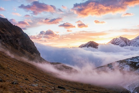 Great view of the foggy valley in Gran Paradiso National Park,  Alps, Italy,  dramatic scene, beautiful world. colourful autumn morning,scenic view with cloudy sky, majestic dawn in mountain landscape