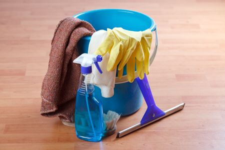 cleaning products on wooden floor