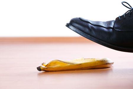 stepping on banana peel on wooden floor
