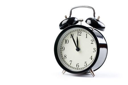 the alarm clock on white background