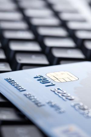 shot of credit card on computer keyboard