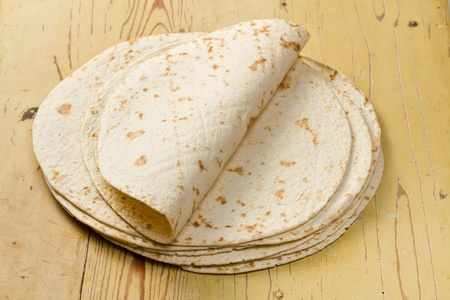 flour tortillas on wooden table