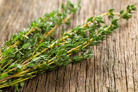 thyme herb on wooden background