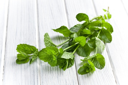 fresh mint leaves on kitchen table