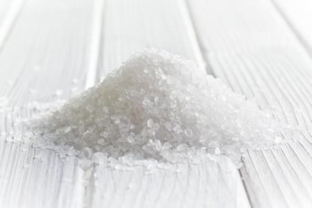 white crystal salt on wooden table