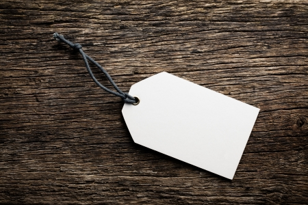 the blank price tag label on wooden background