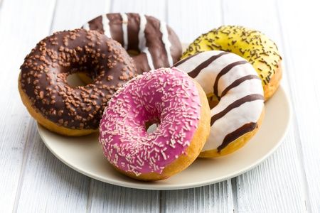 various donuts on kitchen table