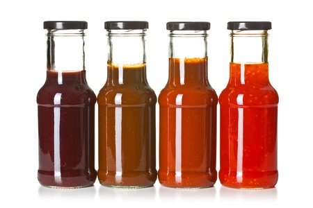the various barbecue sauces in glass bottles