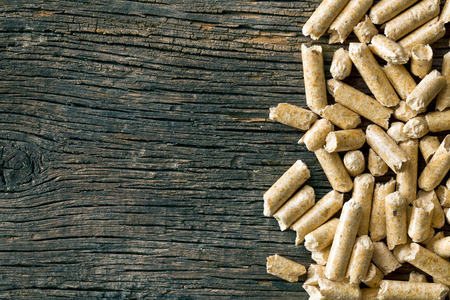 the wooden pellets on old wooden background