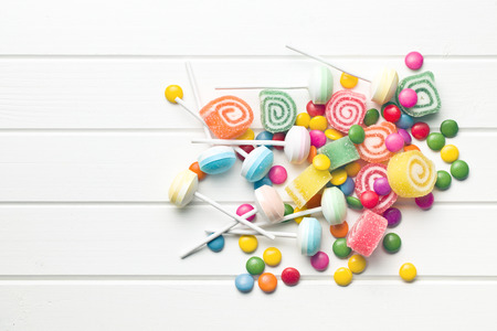 top view of colorful candy on white table