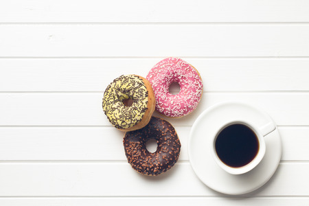 top view of various donuts with coffee