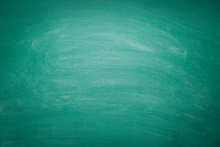 Foto de photo shot of dirty green chalkboard - Imagen libre de derechos
