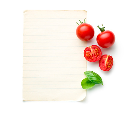 the chopped tomatoes and basil leaf with blank paper