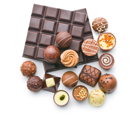Photo pour various chocolate pralines and chocolate bar on white background - image libre de droit