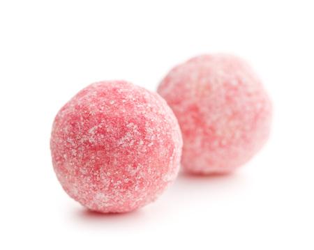 pink marzipan balls on white background