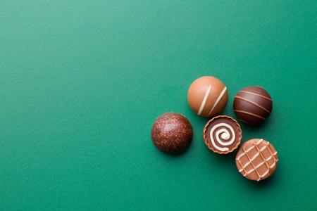 Photo pour chocolate pralines on a green chalkboard - image libre de droit
